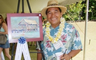 "Best of Show awardee Fred Tangalin with his winning picture, ""Hanalei Pier."