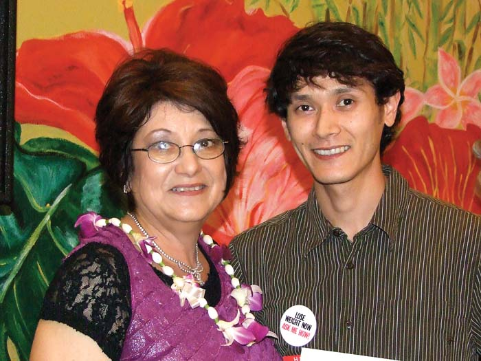 Melinda Uohara, sales and marketing manager of FOR KAUA`I and her son, Bryan. He won Honorable Mention in the Entrepreneur category for his business, New Wave Nutrition.