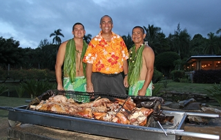 Smith Family Garden Luau GM Kamika Smith, center, with Kiah Imai, left, and Eddie Pagatpatan, right after pulling the Kalua pig from the imu, where it had been baking and steaming for nine hours.