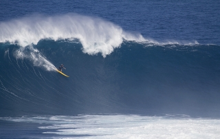 Kaua'i's Danny Fuller drops into a bomb at Peahi, Maui, in December 2012. Photo by Bruno Lemos