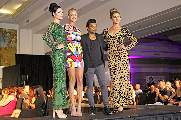 Meghan King Edmonds of Real Housewives of Orange County, center, with Sha Ali Ahmad of Ahmad Couture, are seen here flanked by two models.
