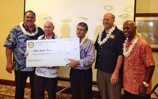 Mayor Bernard Carvalho Jr., left, and Aloha Angels President Ric Cox are seen here receiving a $103,800 check from, left to right, Rotary Club of Kapa'a Foundation President Jim Saylor, former RCK President Ron Margolis and RCK President-Elect Ronald Lemay.