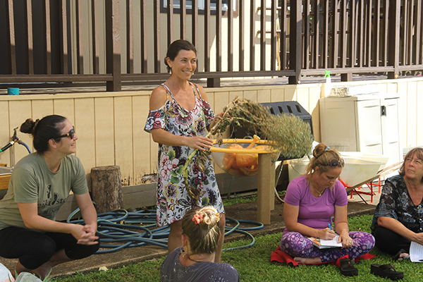Tiana Kamen shows early childhood educators how easy it is to plant lettuce, during a workshop at Na Pua Keiki Preschool in February.